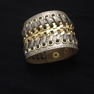 Jewelry - Bronze leather bracelet with gold chain accents.